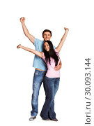 Купить «Young couple cheering at camera», фото № 30093144, снято 2 июля 2014 г. (c) Wavebreak Media / Фотобанк Лори