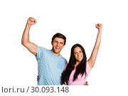 Купить «Young couple cheering at camera», фото № 30093148, снято 2 июля 2014 г. (c) Wavebreak Media / Фотобанк Лори