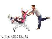Купить «Man pushing woman in trolley», фото № 30093492, снято 4 июля 2014 г. (c) Wavebreak Media / Фотобанк Лори