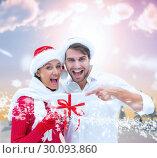 Купить «Composite image of festive young couple holding gift», фото № 30093860, снято 26 августа 2014 г. (c) Wavebreak Media / Фотобанк Лори