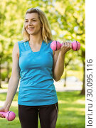 Купить «Fit blonde lifting dumbbells in the park», фото № 30095116, снято 28 мая 2014 г. (c) Wavebreak Media / Фотобанк Лори