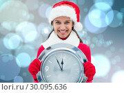 Купить «Composite image of festive brunette holding clock», фото № 30095636, снято 28 августа 2014 г. (c) Wavebreak Media / Фотобанк Лори