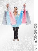 Купить «Composite image of portrait of a woman showing shopping bags», фото № 30096036, снято 29 августа 2014 г. (c) Wavebreak Media / Фотобанк Лори