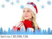 Купить «Composite image of festive blonde holding shopping bags», фото № 30096136, снято 29 августа 2014 г. (c) Wavebreak Media / Фотобанк Лори