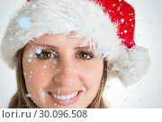 Купить «Composite image of close up portrait of pretty woman in santa hat», фото № 30096508, снято 29 августа 2014 г. (c) Wavebreak Media / Фотобанк Лори