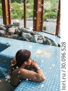Купить «Composite image of brunette relaxing in a jacuzzi», фото № 30096528, снято 29 августа 2014 г. (c) Wavebreak Media / Фотобанк Лори