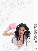 Купить «Composite image of a worried young woman holding an empty piggy bank», фото № 30096736, снято 29 августа 2014 г. (c) Wavebreak Media / Фотобанк Лори