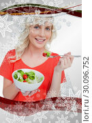Купить «Composite image of young smiling woman eating a fresh salad with a fork», фото № 30096752, снято 29 августа 2014 г. (c) Wavebreak Media / Фотобанк Лори