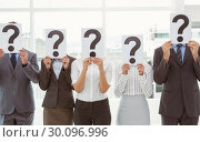Купить «Business people holding question mark signs in office», фото № 30096996, снято 8 мая 2014 г. (c) Wavebreak Media / Фотобанк Лори