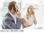 Купить «Business people using mobile phones», фото № 30097256, снято 8 мая 2014 г. (c) Wavebreak Media / Фотобанк Лори