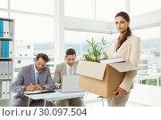 Купить «Businesswoman carrying her belongings in box», фото № 30097504, снято 8 мая 2014 г. (c) Wavebreak Media / Фотобанк Лори