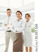 Купить «Confident business people with arms crossed in office», фото № 30097568, снято 8 мая 2014 г. (c) Wavebreak Media / Фотобанк Лори