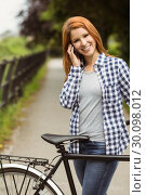 Portrait of a pretty redhead on the phone. Стоковое фото, агентство Wavebreak Media / Фотобанк Лори
