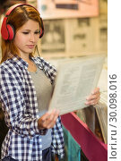 Купить «Girl looking for vinyl while listening to music», фото № 30098016, снято 13 июня 2014 г. (c) Wavebreak Media / Фотобанк Лори