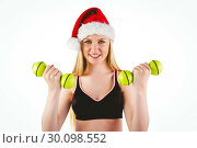 Купить «Festive fit blonde smiling at camera», фото № 30098552, снято 18 июля 2014 г. (c) Wavebreak Media / Фотобанк Лори