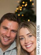 Купить «Smiling couple looking at the camera», фото № 30098936, снято 24 июля 2014 г. (c) Wavebreak Media / Фотобанк Лори