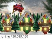 Купить «Composite image of santa flying his sleigh», фото № 30099160, снято 10 октября 2014 г. (c) Wavebreak Media / Фотобанк Лори