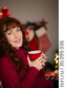 Купить «Portrait of pretty redhead enjoying hot drink», фото № 30099936, снято 3 октября 2014 г. (c) Wavebreak Media / Фотобанк Лори
