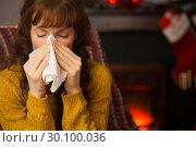 Купить «Woman sitting on sofa and blowing her nose at christmas», фото № 30100036, снято 3 октября 2014 г. (c) Wavebreak Media / Фотобанк Лори