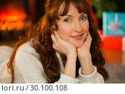 Купить «Smiling woman is resting her head on her hands», фото № 30100108, снято 3 октября 2014 г. (c) Wavebreak Media / Фотобанк Лори