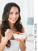 Купить «Brunette having breakfast in bed», фото № 30100236, снято 2 октября 2014 г. (c) Wavebreak Media / Фотобанк Лори