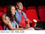 Купить «Young couple watching a film», фото № 30100324, снято 22 ноября 2014 г. (c) Wavebreak Media / Фотобанк Лори