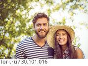 Купить «Hipster couple smiling at camera», фото № 30101016, снято 19 ноября 2014 г. (c) Wavebreak Media / Фотобанк Лори