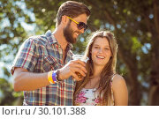 Купить «Hipster couple smiling at each other», фото № 30101388, снято 19 ноября 2014 г. (c) Wavebreak Media / Фотобанк Лори