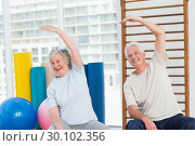 Купить «Senior couple doing stretching exercise in gym», фото № 30102356, снято 13 ноября 2014 г. (c) Wavebreak Media / Фотобанк Лори