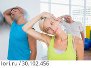 Купить «People doing neck exercise in fitness club», фото № 30102456, снято 13 ноября 2014 г. (c) Wavebreak Media / Фотобанк Лори
