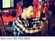 Купить «Worker processing leather for belt», фото № 30103664, снято 26 марта 2019 г. (c) Яков Филимонов / Фотобанк Лори