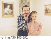 Купить «Father and small daughter exploring pictorial art», фото № 30103692, снято 19 марта 2019 г. (c) Яков Филимонов / Фотобанк Лори