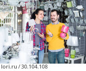 Купить «Happy customers in shop of home appliances are choosing night lamp», фото № 30104108, снято 16 февраля 2017 г. (c) Яков Филимонов / Фотобанк Лори