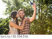 Купить «Hipster couple taking a selfie», фото № 30104516, снято 19 ноября 2014 г. (c) Wavebreak Media / Фотобанк Лори