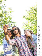 Купить «Happy friends taking a selfie», фото № 30104864, снято 19 ноября 2014 г. (c) Wavebreak Media / Фотобанк Лори