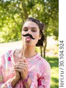 Купить «Pretty brunette with fake mustache», фото № 30104924, снято 19 ноября 2014 г. (c) Wavebreak Media / Фотобанк Лори