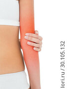 Купить «Closeup mid section of a fit woman with elbow pain», фото № 30105132, снято 15 октября 2013 г. (c) Wavebreak Media / Фотобанк Лори