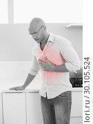Купить «Casual man suffering from chest pain at home», фото № 30105524, снято 1 августа 2013 г. (c) Wavebreak Media / Фотобанк Лори