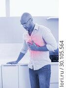 Купить «Casual man suffering from chest pain at home», фото № 30105564, снято 1 августа 2013 г. (c) Wavebreak Media / Фотобанк Лори