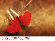 Купить «Composite image of hearts hanging on line», фото № 30106708, снято 19 января 2015 г. (c) Wavebreak Media / Фотобанк Лори