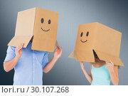 Купить «Composite image of couple wearing emoticon face boxes on their heads», фото № 30107268, снято 19 января 2015 г. (c) Wavebreak Media / Фотобанк Лори