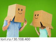 Купить «Composite image of couple wearing emoticon face boxes on their heads», фото № 30108400, снято 21 января 2015 г. (c) Wavebreak Media / Фотобанк Лори