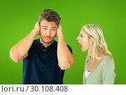 Composite image of man not listening to his shouting girlfriend. Стоковое фото, агентство Wavebreak Media / Фотобанк Лори