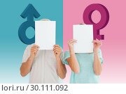 Купить «Composite image of couple holding paper over their faces», фото № 30111092, снято 23 января 2015 г. (c) Wavebreak Media / Фотобанк Лори