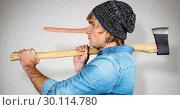 Купить «Composite image of side view of hipster standing with axe», фото № 30114780, снято 5 февраля 2016 г. (c) Wavebreak Media / Фотобанк Лори