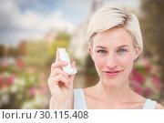 Купить «Composite image of pretty woman holding inhaler smiling at camera », фото № 30115408, снято 27 апреля 2016 г. (c) Wavebreak Media / Фотобанк Лори
