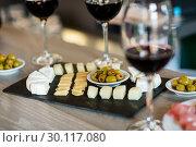 Купить «Wine and food arranged on table», фото № 30117080, снято 6 апреля 2016 г. (c) Wavebreak Media / Фотобанк Лори