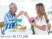 Mature couple toasting wineglass in restaurant. Стоковое фото, агентство Wavebreak Media / Фотобанк Лори
