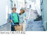 Купить «Happy mature couple with bicycle», фото № 30117432, снято 3 февраля 2016 г. (c) Wavebreak Media / Фотобанк Лори