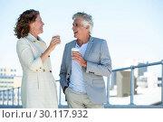 Купить «Happy couple enjoying coffee», фото № 30117932, снято 3 февраля 2016 г. (c) Wavebreak Media / Фотобанк Лори